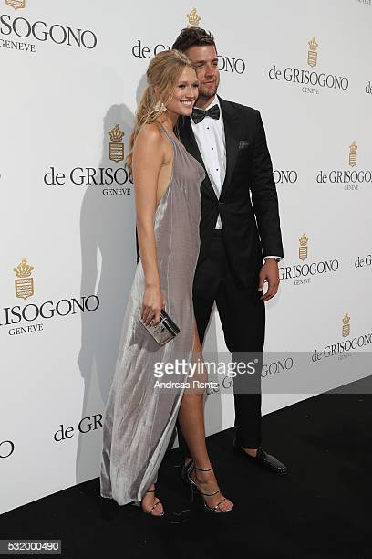 Toni Garrn and Chandler Parsonsattends the De Grisogono Party during the annual 69th Cannes Film Festival at Hotel du CapEdenRoc on May 17 2016 in...