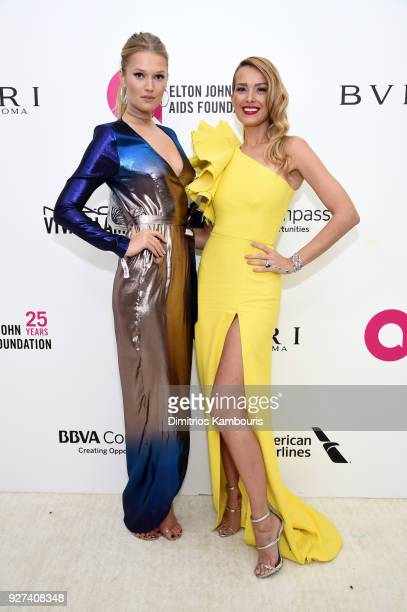 Toni Garrn and Petra Nemcova attend the 26th annual Elton John AIDS Foundation Academy Awards Viewing Party sponsored by Bulgari celebrating EJAF and...