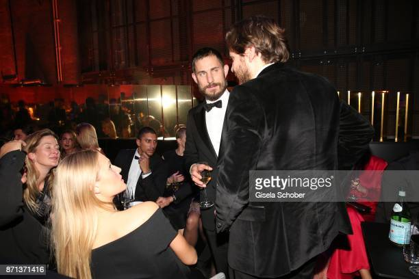 Toni Garrn Andreas Bourani Clemens Schick Daniel Bruehl during the aftershow party of the 24th Opera Gala benefit to Deutsche AidsStiftung at...