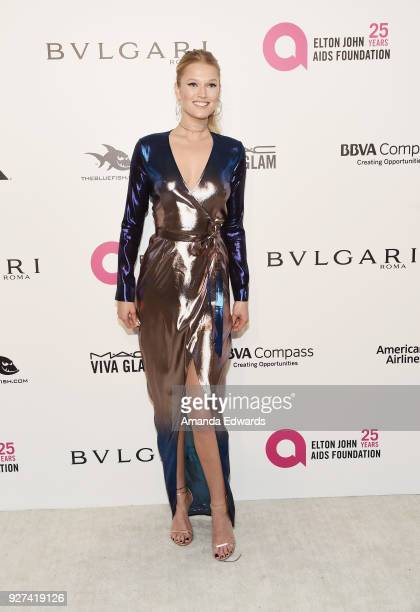 Toni Garrn arrives at the 26th Annual Elton John AIDS Foundation's Academy Awards Viewing Party on March 4 2018 in West Hollywood California