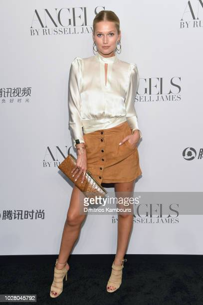Toni Garrn attends the 'ANGELS' by Russell James book launch and exhibit hosted by Cindy Crawford and Candice Swanepoel at Stephan Weiss Studio on...