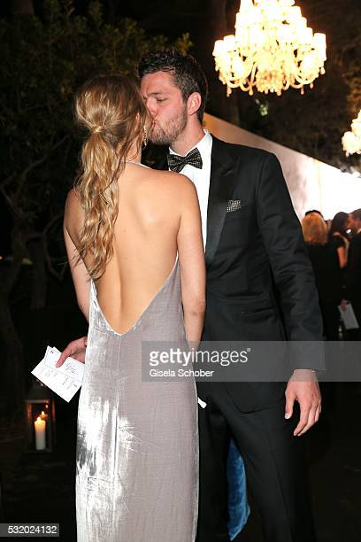 Toni Garrn kisses her boyfriend Chandler Parson during the 'De Grisogono' Party at the annual 69th Cannes Film Festival at Hotel du CapEdenRoc on May...