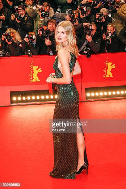 Toni Garrn wearing a dress from Hugo Boss attends the 'Hail Caesar' Premiere during the 66th Berlinale International Film Festival on February 11...