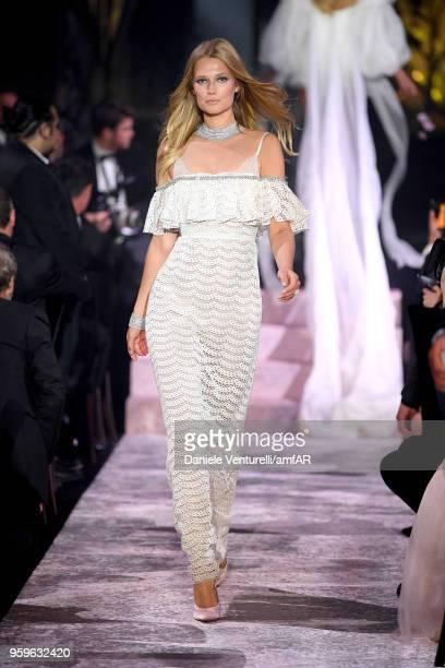 Toni Garrn wearing Giambattista Valli walks the runway at the amfAR Gala Cannes 2018 at Hotel du CapEdenRoc on May 17 2018 in Cap d'Antibes France