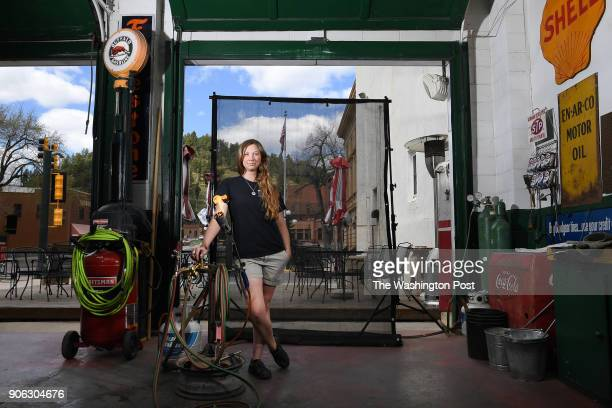 Toni Gerlach a glass blower and owner of Mind Blown Studio poses for a portrait on Thursday May 11 2017 in Deadwood SD