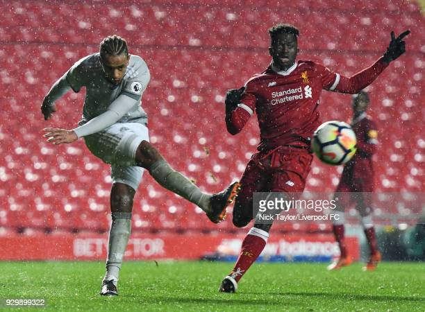 Toni Gomes of Liverpool and Cameron BorthwickJackson of Manchester United in action during the Premier League 2 match between Liverpool and...