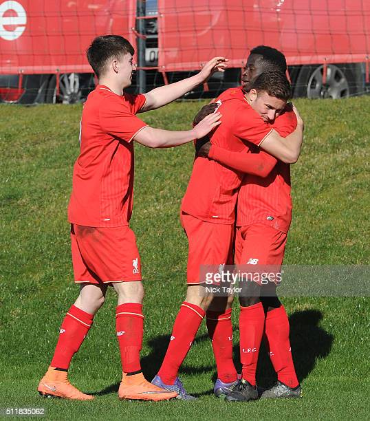 Toni Gomes of Liverpool celebrates scoring his third goal of the game with team mates Ben Woodburn and Herbie Kane during U18 Premier League match...
