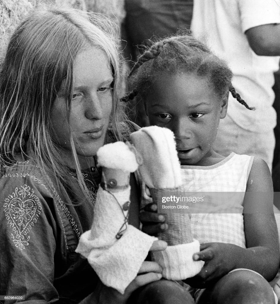 Toni Hilsinger, 16, of Dedham and Allison Bell, 6, of East Boston try out puppets made at a Summerthing event in Boston on Jul. 8, 1971.
