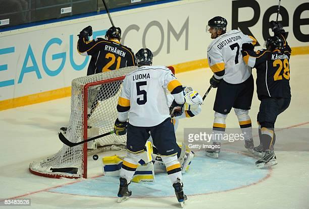 Toni Kahkonen of Espoo Blues shoots a goal during the IIHF Champions Hockey League match between Espoo Blues and HV71 Jonkoping on October 29, 2008...