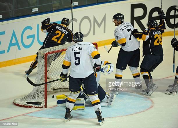 Toni Kahkonen shoots a goal during the IIHF Champions Hockey League match between Espoo Blues and HV71 Jonkoping on October 29, 2008 in Espoo,...