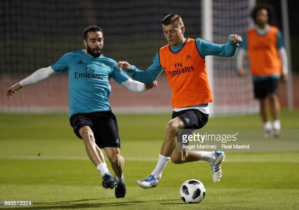 Toni Kroos and Daniel Carvajal of Real Madrid in action during a training session at the New York University stadium on December 15 2017 in Abu Dhabi...