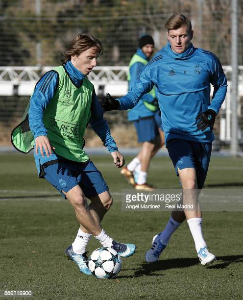 Toni Kroos and Luka Modric of Real Madrid in action during a training session at Valdebebas training ground on December 5 2017 in Madrid Spain