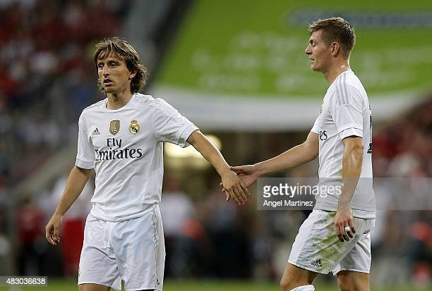 Toni Kroos and Luka Modric of Real Madrid shake hands during the Audi Cup 2015 match between FC Bayern Muenchen and Real Madrid at Allianz Arena on...