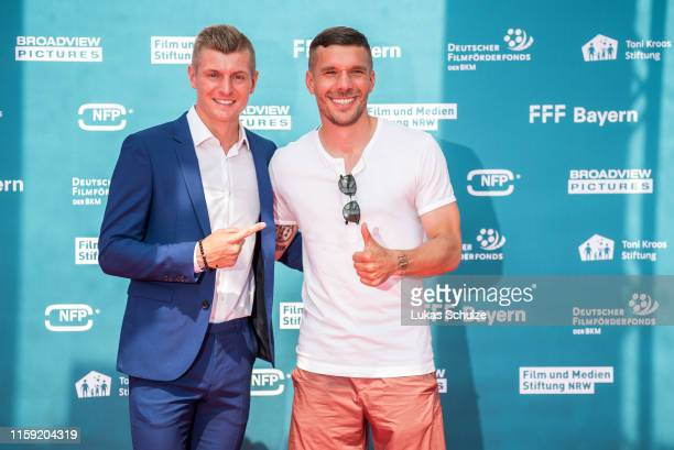 """Toni Kroos and Lukas Podolski attend the world premiere of the film """"Kroos"""" at Cinedom on June 30, 2019 in Cologne, Germany."""