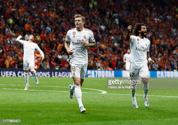 Toni Kroos and Marcelo of Real Madrid celebrate after scoring during the UEFA Champions League group A match between Galatasaray and Real Madrid at...