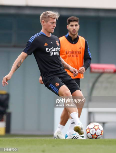Toni Kroos and Marco Asensio of Real Madrid are training at Valdebebas training ground on October 16, 2021 in Madrid, Spain.
