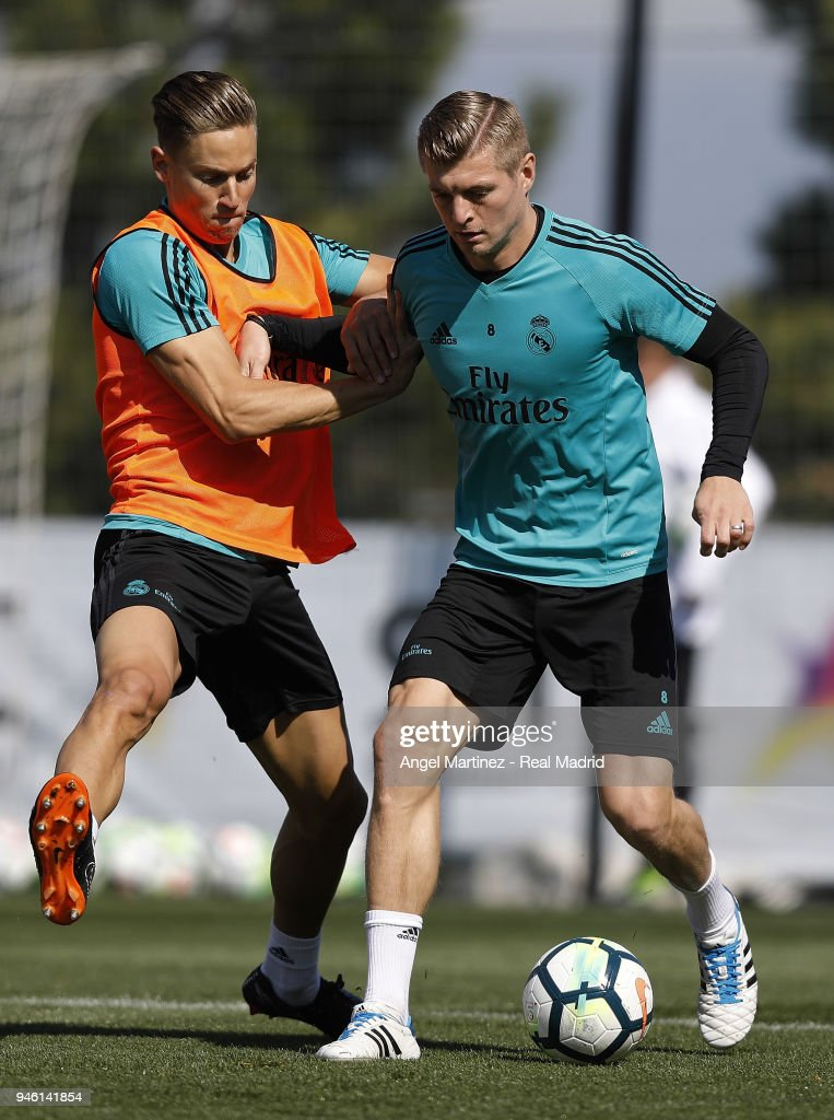 Toni Kroos (R) and Marcos Llorente of Real Madrid in action during a training session at Valdebebas training ground on April 14, 2018 in Madrid, Spain.