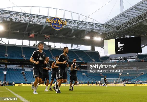 Toni Kroos and Nacho Fernandez of Real Madrid warm up during a training session at Hard Rock Stadium on July 30 2018 in Miami Florida