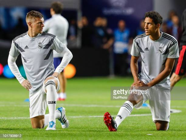 Toni Kroos and Raphael Varane of Real Madrid during the warmup ahead of the UEFA Super Cup match between Real Madrid and Atletico Madrid on August 15...