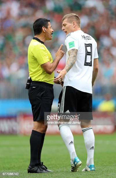 Toni Kroos and referee Alireza Faghani in action during the 2018 FIFA World Cup Russia group F match between Germany and Mexico at Luzhniki Stadium...