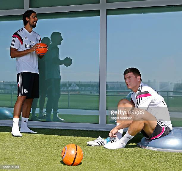 Toni Kroos and Sami Khedira of Real Madrid attend a training session at Valdebebas training ground on August 5 2014 in Madrid Spain