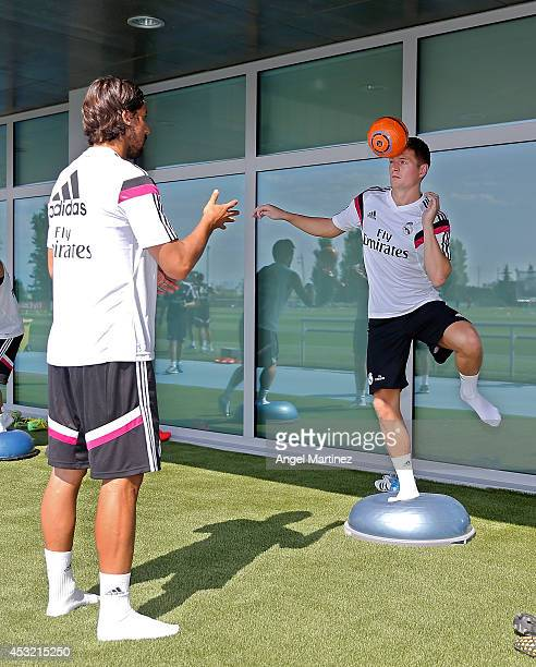Toni Kroos and Sami Khedira of Real Madrid exercise during a training session at Valdebebas training ground on August 5 2014 in Madrid Spain