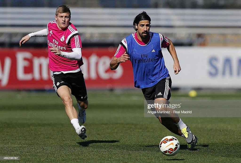 Toni Kroos (L) and Sami Khedira of Real Madrid in action during a training session at Valdebebas training ground on March 4, 2015 in Madrid, Spain.