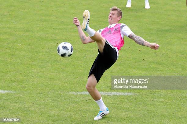 Toni Kroos battles for the ball during a training session of the German national team at Sportanlage Rungg on day sixteen of the Southern Tyrol...