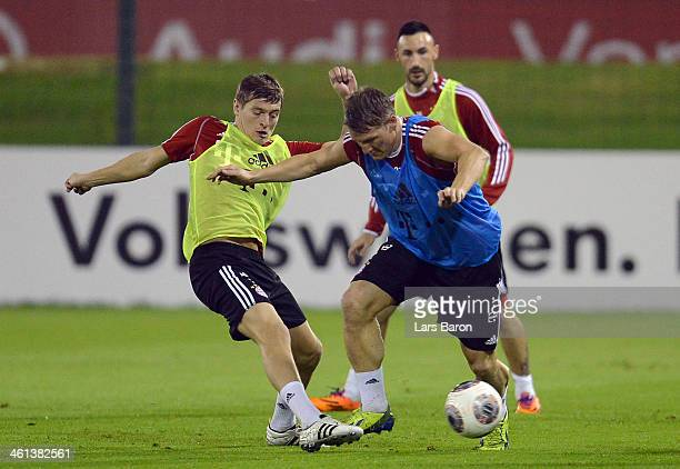 Toni Kroos challenges Bastian Schweinsteiger during a training session at day 4 of the Bayern Muenchen training camp at ASPIRE Academy for Sports...