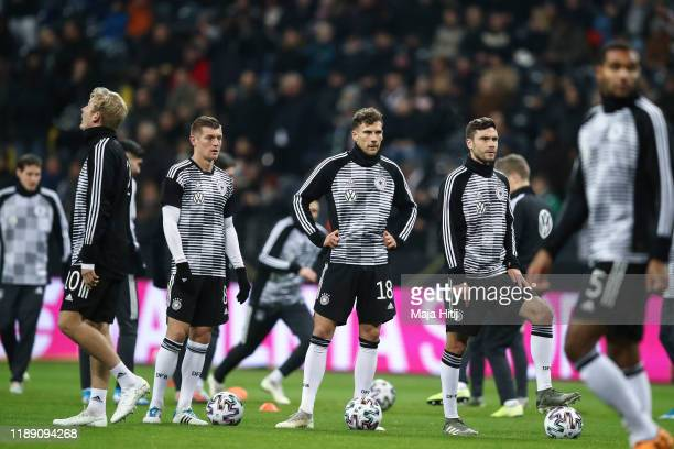 Toni Kroos , Leon Goretzka and Jonas Hector of Germany warm up prior to the UEFA Euro 2020 Qualifier between Germany and Northern Ireland at...
