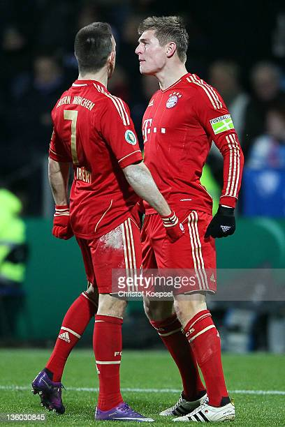 Toni Kroos of Bayern celebrates the first goal with Franck Ribery of Bayern during the DFB Cup round of sixteen match between VfL Bochum and FC...