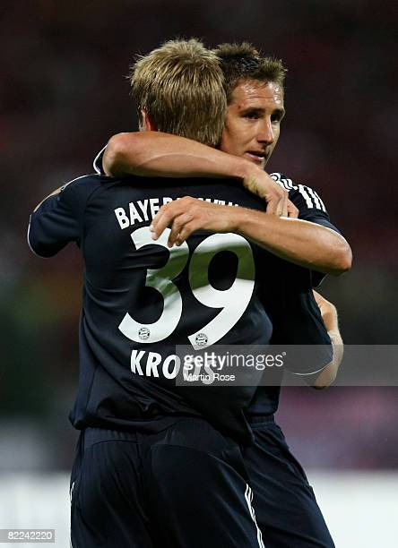 Toni Kroos of Bayern Muenchen celebrates with team mate Miroslav Klose after scoring th 4th goal during DFB Cup first round match between RotWeiss...