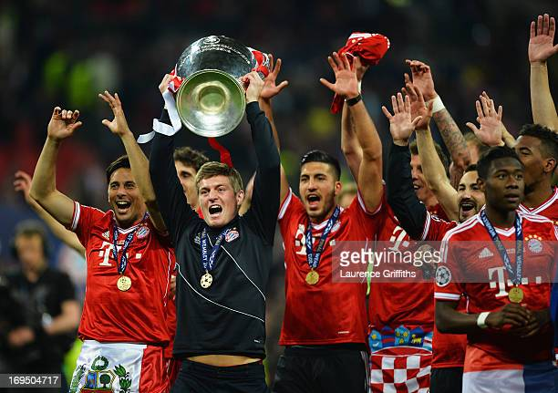 Toni Kroos of Bayern Muenchen celebrates with the trophy with team mates after victory in the UEFA Champions League final match between Borussia...