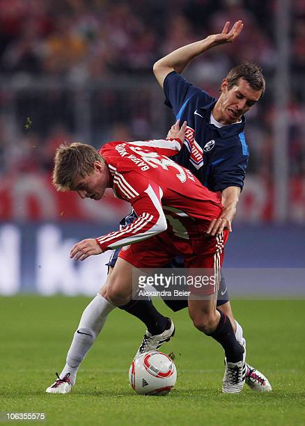 Toni Kroos of Bayern Muenchen fights for the ball with Julian Schuster of Freiburg during the Bundesliga match between FC Bayern Muenchen and SC...