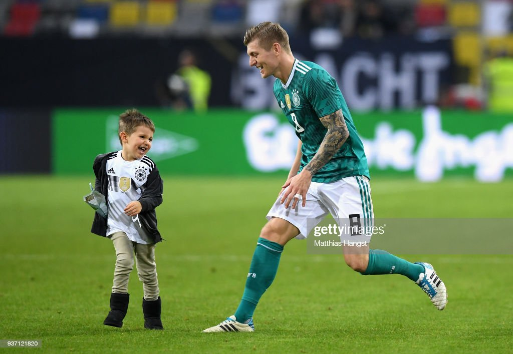 Toni Kroos of Germany and his son Leon Kroos play on the pitch after the International friendly match between Germany and Spain at Esprit-Arena on March 23, 2018 in Duesseldorf, Germany.