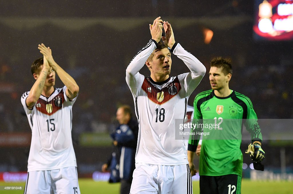 Toni Kroos (C) of Germany and his team-mates thanks the fans for their support after the International Friendly match between Spain and Germany at Estadio Balaidos on November 18, 2014 in Vigo, Spain.