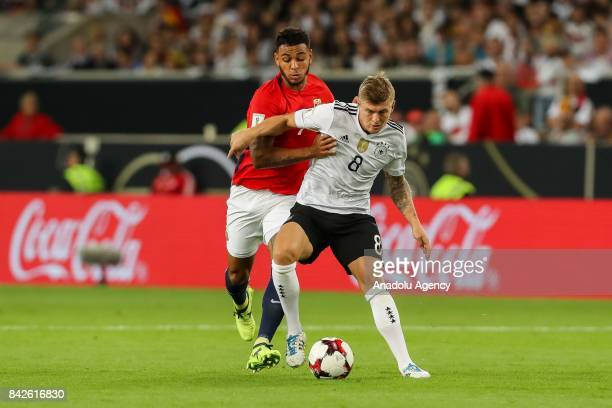 Toni Kroos of Germany and Joshua King of Norway vie for the ball during the FIFA 2018 World Cup Qualifier between Germany and Norway at MercedesBenz...