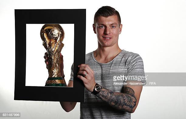 Toni Kroos of Germany and Real Madrid poses with the FIFA World Cup trophy prior to The Best FIFA Football Awards at Kameha Zurich Hotel on January 9...