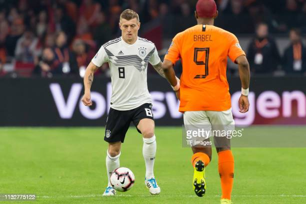 Toni Kroos of Germany and Ryan Babel of Netherlands battle for the ball during the 2020 UEFA European Championships group C qualifying match between...