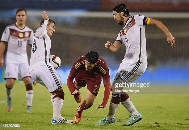Toni Kroos of Germany and Sami Khedira of Germany block Isco of Spain during the International Friendly match between Spain and Germany at Estadio...