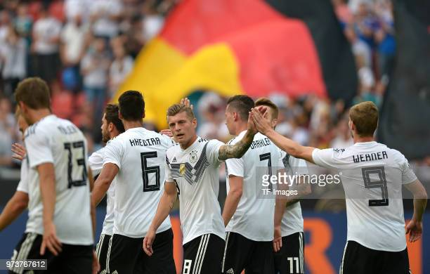 Toni Kroos of Germany and Timo Werner of Germany celebrate after Omar Hawsawi of Saudi Arabia scored an own goal during the international friendly...