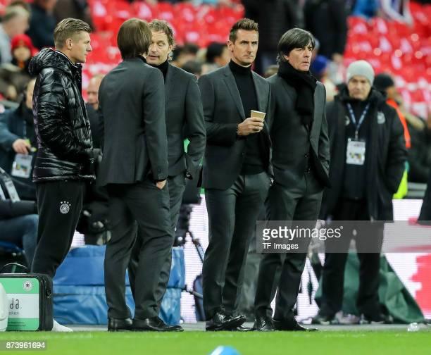 Toni Kroos of Germany Assistant coach Thomas Schneider of Germany Assistant coach Marcus Sorg of Germany Miroslav Klose Head hoach Joachim Loew of...
