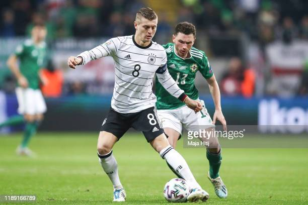 Toni Kroos of Germany battle for possession with Corry Evans of Northern Ireland during the UEFA Euro 2020 Qualifier between Germany and Northern...