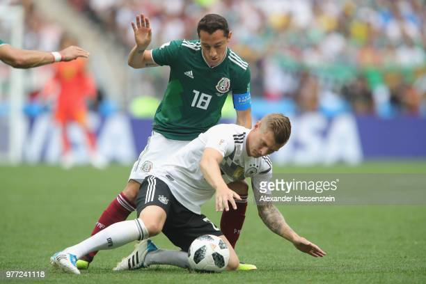 Toni Kroos of Germany battles for the ball with Andres Guardado of Mexico during the 2018 FIFA World Cup Russia group F match between Germany and...
