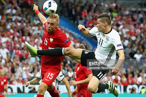 Toni Kroos of Germany battles for the ball with Kamil Glik during the UEFA EURO 2016 Group C match between Germany and Poland at Stade de France on...