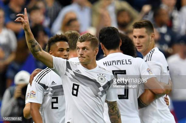Toni Kroos of Germany celebrates after scoring his team's first goal during the UEFA Nations League A group one match between France and Germany at...