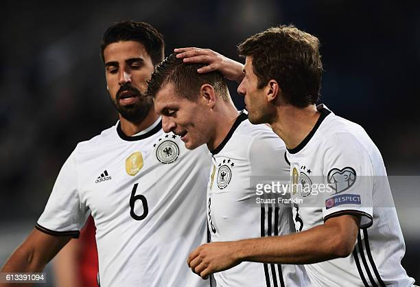 Toni Kroos of Germany celebrates scoring his goal with Thomas Mueller and Sami Khedira during the 2018 FIFA World Cup Qualifier match between Germany...