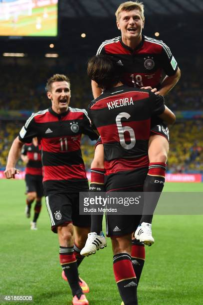 Toni Kroos of Germany celebrates scoring his team's fourth goal and his second of the game with teammates Miroslav Klose and Sami Khedira during the...