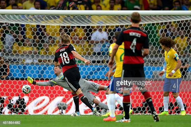 Toni Kroos of Germany celebrates scoring his team's third goal during the 2014 FIFA World Cup Brazil Semi Final match between Brazil and Germany at...