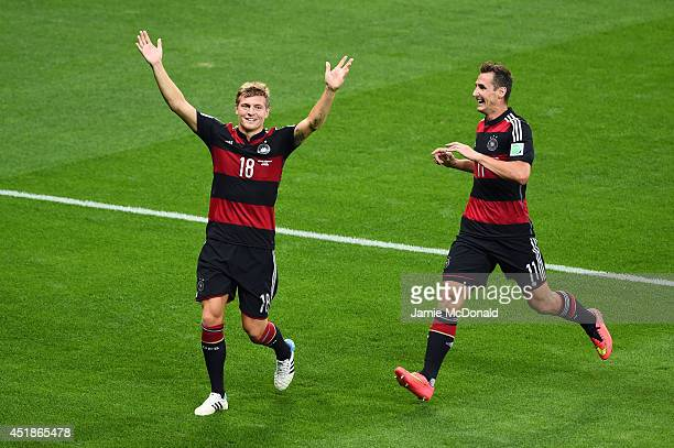Toni Kroos of Germany celebrates scoring his team's third goal with Miroslav Klose during the 2014 FIFA World Cup Brazil Semi Final match between...
